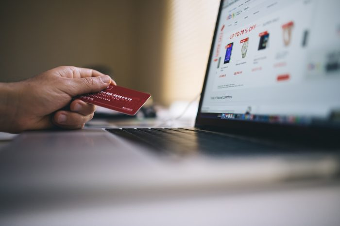 Man using credit card on his computer