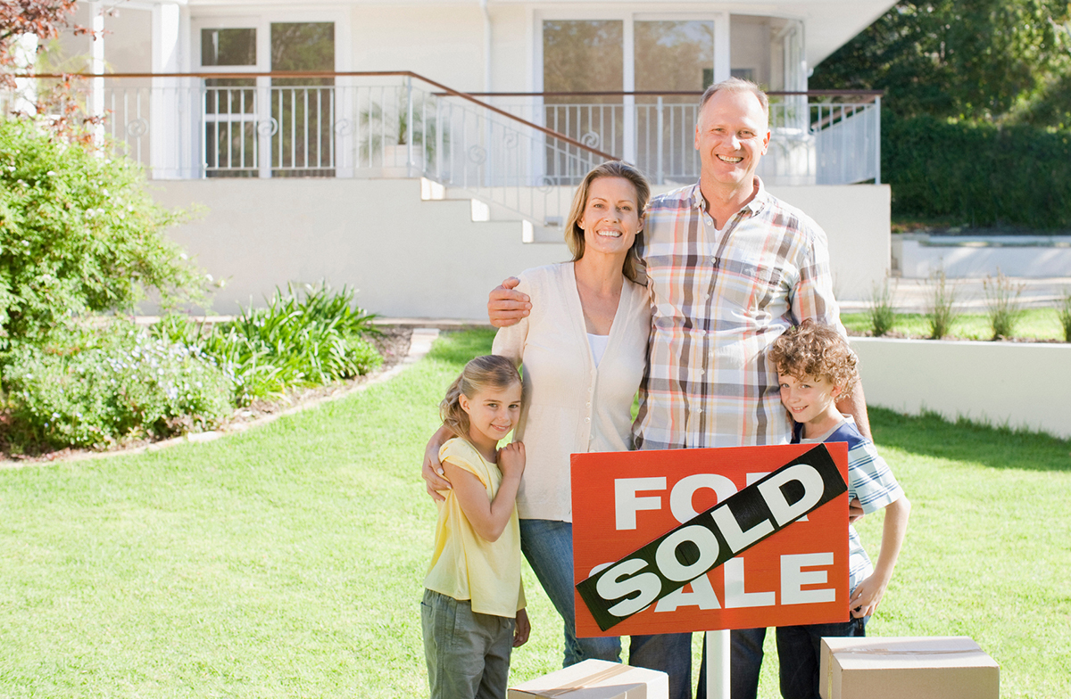 Family with sold sign
